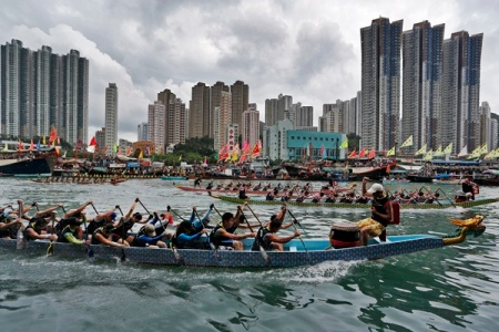 Participants compete in a dragon boat race near Hong Kong's Aberdeen island Saturday, June 23, 2012 as part of celebrations marking the Chinese Dragon Boat Festival, held throughout Hong Kong. (AP Photo/Vincent Yu)